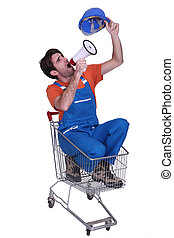 Construction worker in a trolley with a megaphone