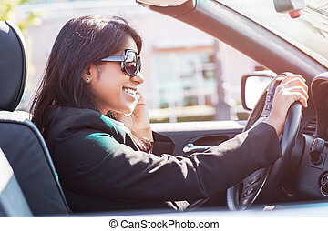 Indian busineswoman driving car - A shot of an Indian...
