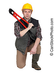 Man kneeling with bolt-cutter