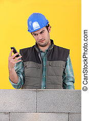 Worker readin a text message