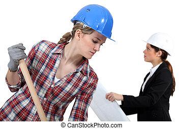 Labourer working beside an engineer