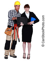 Architect and builder looking at a laptop