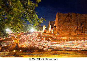 Buddhism Ceremony at temple ruin - candle light trail of...