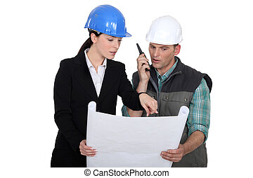 Architect discussing plans with a foreman