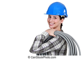 female plumber holding a pipe hose