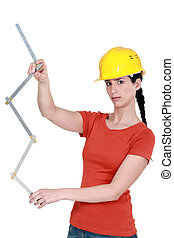 Construction worker holding a ruler