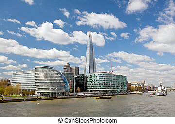 London City Hall Skylines along River Thames against blue...