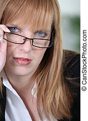 Blonde woman with glasses