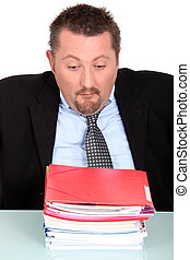 Man overwhelmed by paperwork