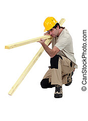 woodworker making a fence