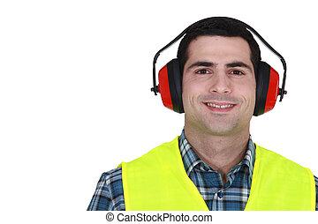 Construction worker in earmuffs