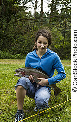 Young Girl Catches Trophy Trout - Young girl holding trophy...