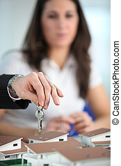 Agent with the keys to a new home