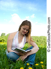Young girl rearing book