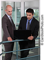 Business colleagues with a laptop