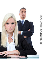 Blonde businesswoman sitting in front of her boss