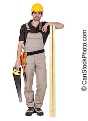 Portrait of a carpenter with a handsaw