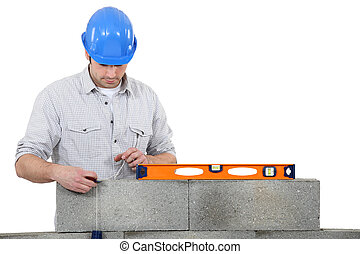 bricklayer erecting concrete wall