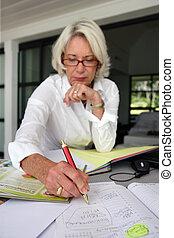 Mature woman writing