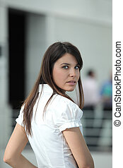 Young woman with long brown hair caught unawares