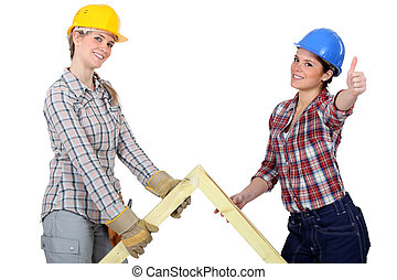 Two women with wooden truss