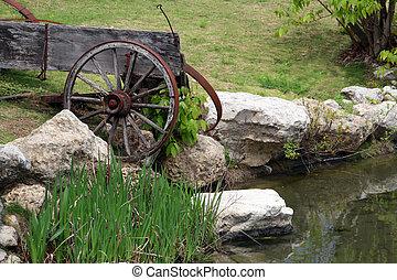 Old Broken Down Wagon - An old broken down wagon near a pond