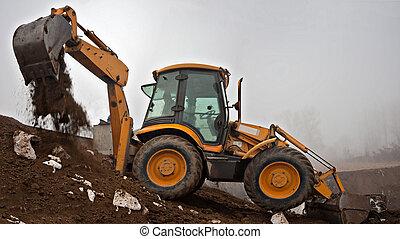 Loader - Wheel loader Excavator with backhoe digging trench...