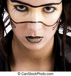 Masked beauty - Young girl with fantasy make-up as if...