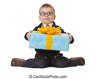Small boy in spectacles with big present - Small sitting boy...