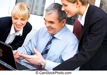 Teamwork - Photo of confident boss pointing at laptop screen...