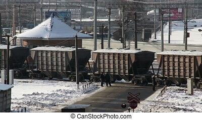 cargo train on cross road in winter city