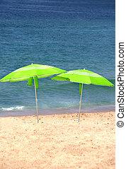 Two green sun umbrellas on the beach - Sea time - two green...