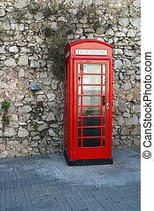 Phone booths - Red telephone box on the street in front of...