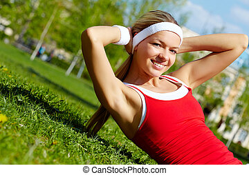 Doing exercise - Portrait of a young woman doing physical...