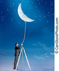 Businessman wants the moon - Concept of a businessman that...