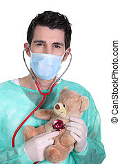 Doctor with a stethoscope and teddy bear