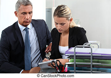 Boss and secretary working together