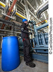 Oil Worker inside refinery - Oil Worker in helmet and...