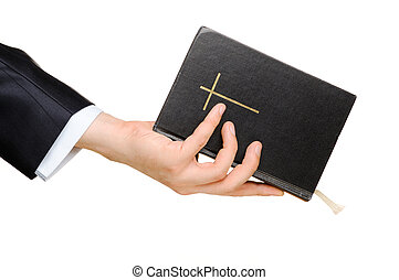 Bible - Hand holding the Bible. Isolated on white