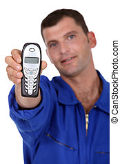 Man holding out telephone