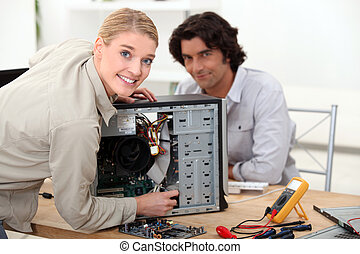 Technician fixing a computer