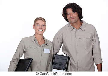 Couple carrying computer