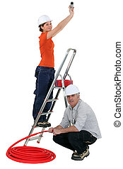 A team of tradespeople installing plumbing