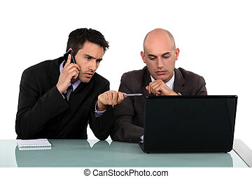 Executives in front of computer