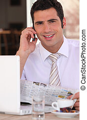 Smiling business consultant relaxing