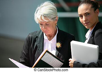 senior businesswoman with her young assistant