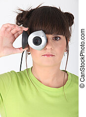 Teenage girl holding a webcam