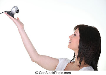 Woman holding a webcam