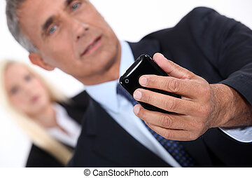 Smart man taking picture with mobile phone
