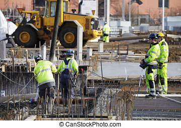 building site with workers - construction industry, workers...